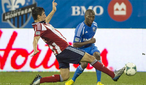 Carlos Borja, left, challenges Montreal's Sanna Nyassi for the ball during second half of Chivas USA's draw with the Impact, 1-1, on July 7, 2013.