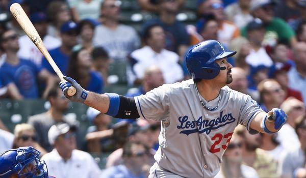 Dodgers first baseman Adrian Gonzalez hits a double during the first inning of the Dodgers' 6-2 victory over the Chicago Cubs on Friday.