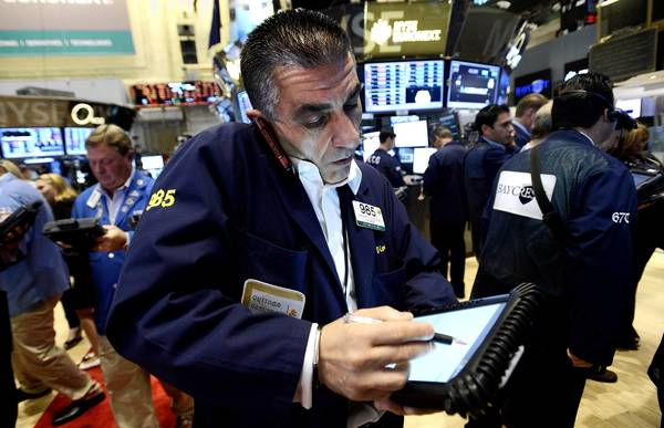 Major U.S. indexes edged higher Friday, but endured no large swings as is typical when the government releases its all-important jobs report at the beginning of each month. Above, a trader works on the floor of the New York Stock Exchange on Friday.
