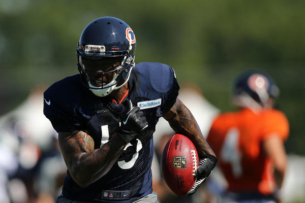 Bears' wide receiver Brandon Marshall runs the ball during training camp Thursday.