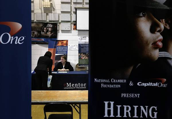 A job seeker talks to a recruiter during a Hiring Our Heroes job fair at a Maryland National Guard station in Silver Spring, Md. HIring Our Heroes is a campagin to help military service members, veterans and their spouses find employment.