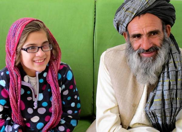 Farida, 11, with her father, Abdul Rauf, who defied the Taliban by allowing her to travel with an American charity to live and get medical care in the U.S.