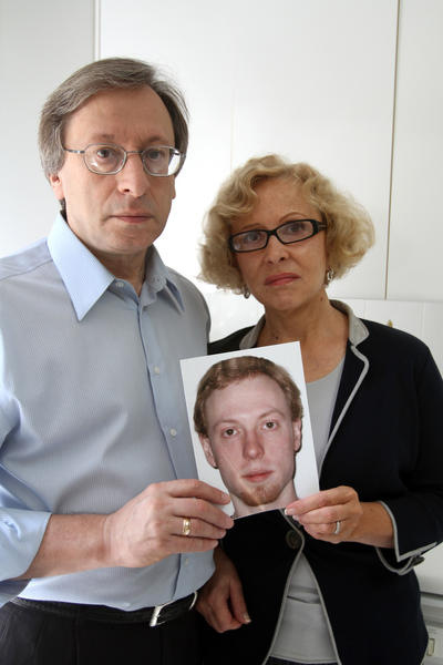 Luda and Roma Gimelfarb pose with a photo of their son David who disappeared while traveling in Costa Rica a year ago Friday, August 6, 2010.
