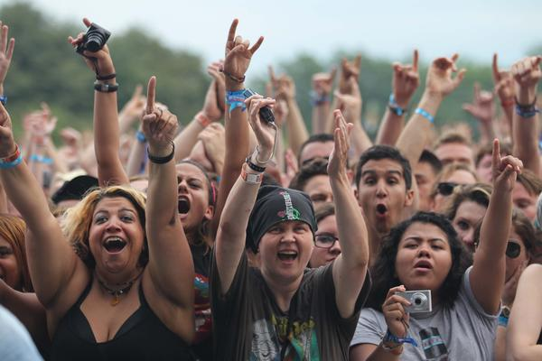 Fans react to Queens of the Stone Age at Lollapalooza Friday night in Chicago.