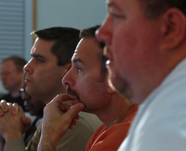 Tribune sports writers David Haugh (left), Dan Pompei (middle) and Brad Biggs (right) as the Bears introduce new general manager Phil Emery at Halas Hall on Jan. 30, 2012.
