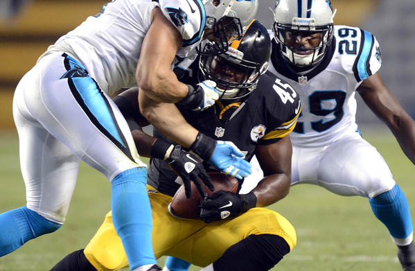 Carolina Panthers Jordan Senn (57) and Jordan Pugh (29) close in on Pittsburgh Steelers' Leonard Pope (45) during the first half of their preseason game on Aug. 30.