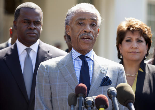 Rev. Al Sharpton speaks, center, flanked by La Raza President Janet Murguia, right, and Atlanta Mayor Kasim Reed, speaks to reporters about the Voting Rights Act, outside the West Wing of the White House in Washington, after a meeting with President Barack Obama and Attorney General Eric Holder.