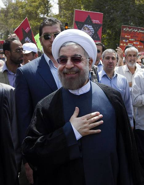Iran's President-elect Hassan Rouhani takes part in a parade marking Al Quds International Day in Tehran on Aug. 2.