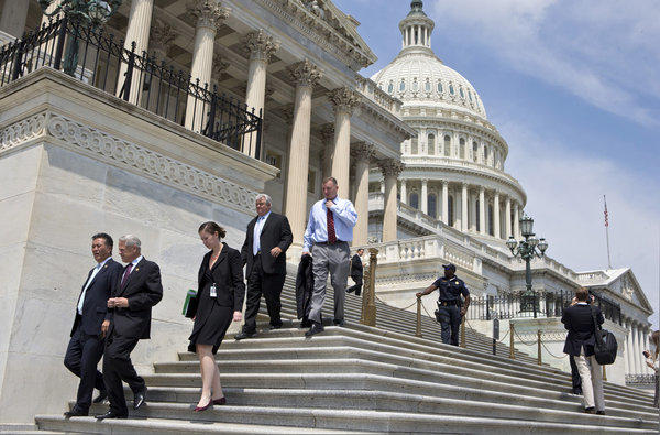After final votes were cast, members of Congress walked down the steps of the House of Representatives on Capitol Hill in Washington as they left for a five-week recess.