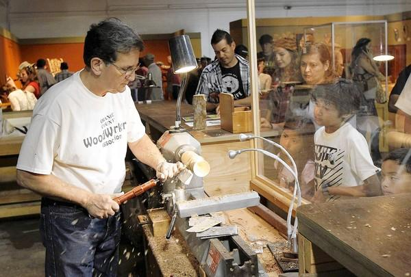 James Santhon carefully makes a goblet during a demonstration for visitors to the OC Fair's crafts exhibition hall.