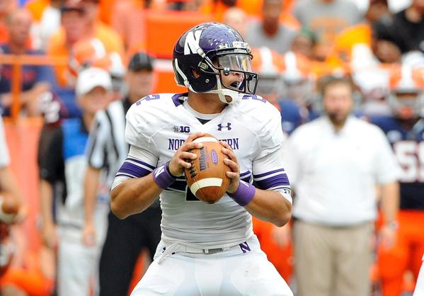 Northwestern quarterback Kain Colter drops back to pass during the second quarter.