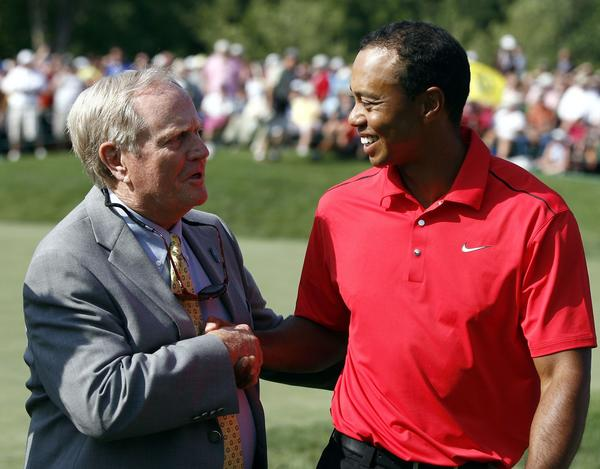 Tiger Woods is congratulated by Jack Nicklaus after his final round of the Memorial Tournament in 2012.