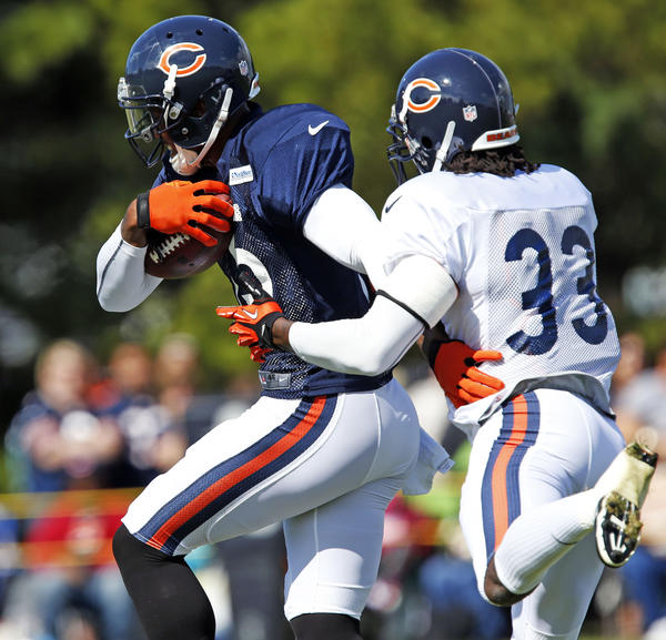 Bears wide receiver Brandon Marshall makes a catch in front of cornerback Charles Tillman during practice.