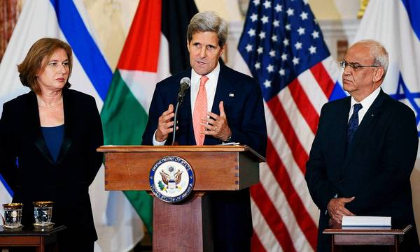 Secretary of State John Kerry delivers remarks as Israeli Justice Minister Tzipi Livni (left) and Palestinian chief negotiator Saeb Erekat (right) listen during a news conference in Washington this week.