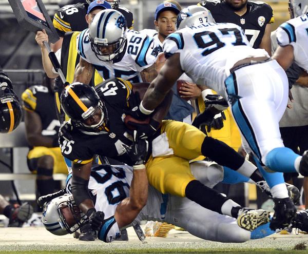 Steelers' Leonard Pope gets wrapped up by the Panthers' Thomas Keiser, Terrell McClain and R.J. Stanford.
