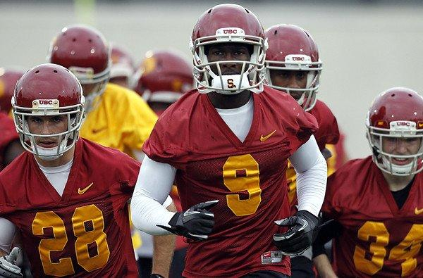Receiver Marqise Lee and Trojans teammates take the field during spring practice at USC.