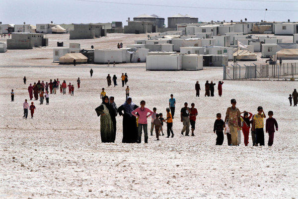 Syrian refugees gather at Za'atari camp in Jordan near the Syrian border in late July.