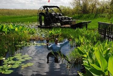 Commissioner Ron Bergeron of the Florida Fish and Wildlife Conservation Commission wants the extremely high water levels in the Everglades lowered to save the wildlife and habitat. The water where he is standing at his Everglades camp would normally be just above his knees.