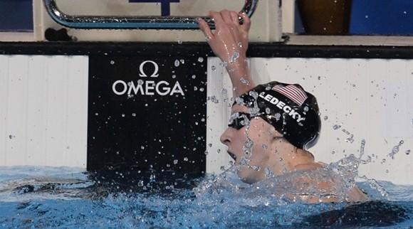 Katie Ledecky tries to catch her breath after setting a world record in the 800-meter freestyle at the World Championships in Barcelona. (Fabrice Coffrini / AFP / Getty Images)
