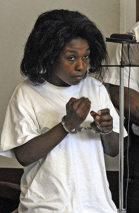 Audrea Gause, 26, of Troy, N.Y., stands during her arraignment Friday, Aug. 2, 2013, in Boston Municipal Court. Gause was charged with filing a false claim for nearly $500,000 with The One Fund Boston, set up to aid Boston Marathon bombing victims.