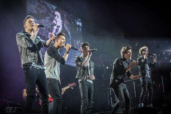 """Liam Payne, left, Louis Tomlinson, Zayn Malik, Harry Styles and Niall Horan perform at a concert featured in """"One Direction: This Is Us."""""""