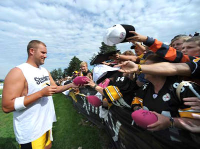 Steelers quarterback Ben Roethlisberger signs autographs during training camp at St. Vincent College in Latrobe.