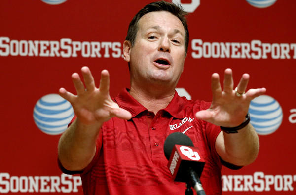 Oklahoma Coach Bob Stoops answers a question at a news conference Saturday in Norman, Okla.