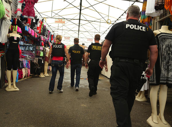 Undercover cops from Lauderhill move through the aisles at the Swap Shop and sweep into a kiosk to confiscate Cloud Nine, a brand of synthetic marijuana.