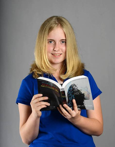 Madison Bowman, 13 of Kutztown, with her latest read 'The Forsaken.'