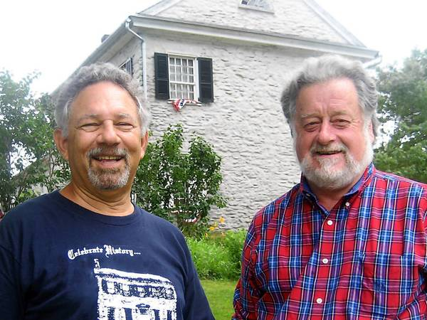 Catasauqua Borough Manager Eugene Goldfeder (left) and architectural preservation expert Tom Jones in front of the historic George Taylor home during the annual 'Red, White and George' fundraising event on July 21.