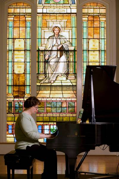 A Moravian College student plays on the Steinway piano in Peter Hall.