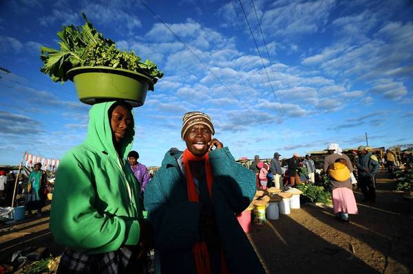 Zimbabwean women shop for vegetables in Jambanja market in Seke, south of Harare, the capital, last week. Zimbabwe President Robert Mugabe's party has been declared the winner of the election last week amid reports of irregularities.