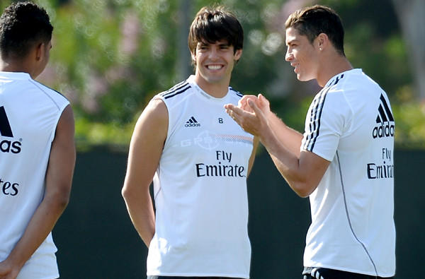 Cristiano Ronaldo, right, talks to Real Madrid teammates Kaka, center, and Carlos Henrique Casimiro during a training session at UCLA on Friday.