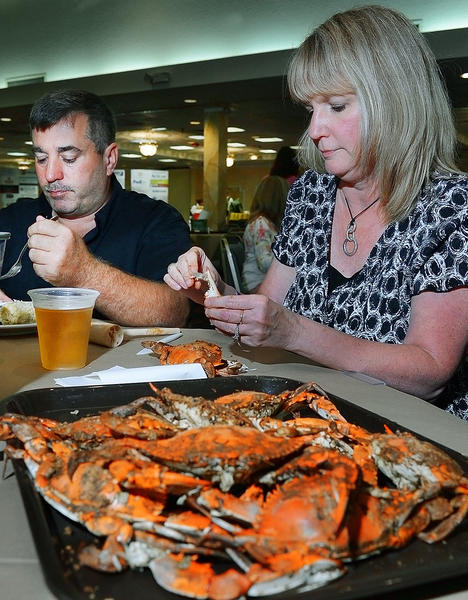 Jim Mills and Sandy Calimer of Hagerstown eat crabs at the Krab & Karaoke fundraiser at Hager Hall on Saturday. The event benefits the Children in Need & Community Free Clinic.