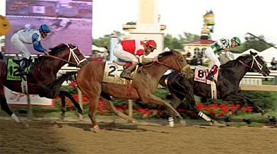 127th Preakness Stakes - Magic Weisner (2) drives past Proud Citizen and nearly catches War Emblem