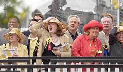 127th Preakness Stakes - Kathleen Walsh cheers during the seventh race