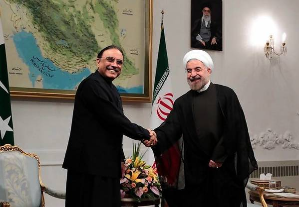 Hassan Rouhani, left, shakes hands with Pakistani President Asif Ali Zardari on Saturday, when Rouhani was formally endorsed by Iran's supreme leader as its new president.
