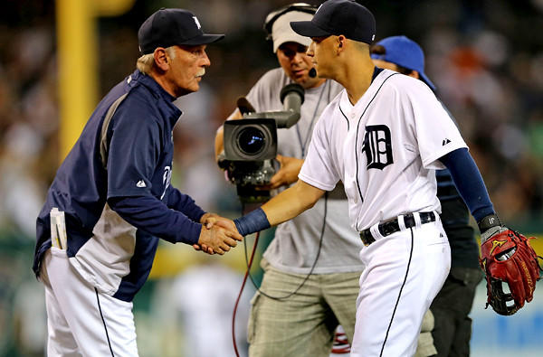 Tigers Manager Jim Leyland celebrates a victory over the Chicago White Sox with recently acquired infielder Jose Iglesias on Friday at Comerica Park in Detroit.
