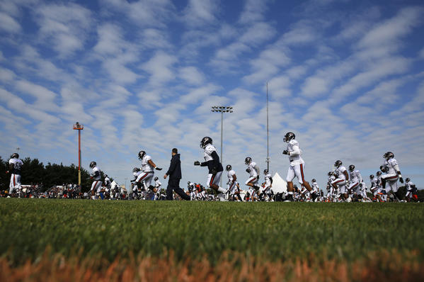 The Bears defensive unit warms up and stretches at summer camp held at Olivet Nazarene University in Bourbonnais July 28, 2013. (Jose M. Osorio/Tribune Photo)