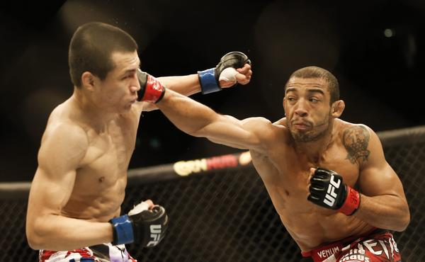 "Jose Aldo, right, delivers a punch to the head of ""Korean Zombie"" Chan Sung Jung during their featherweight bout at UFC 163 in Rio de Janeiro on Saturday. Aldo won the fight."
