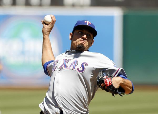 Texas Rangers pitcher Matt Garza delivers a pitch against the Oakland Athletic on Saturday.