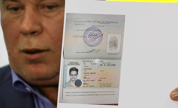A Russian lawyer shows a temporary document to allow Edward Snowden to cross the border into Russia.