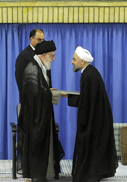 A handout picture released by the official website of the Iranian supreme leader Ayatollah Ali Khamenei on August 3, 2013, shows Khamenei (L) officially endorsing moderate cleric Hassan Rowhani during a ceremony in the capital Tehran. The 64-year-old cleric begins his term as the Islamic republic's seventh president facing grave challenges abroad and at home over Irans ailing economy and isolation resulting from the controversial policies of his predecessor, Mahmoud Ahmadinejad.