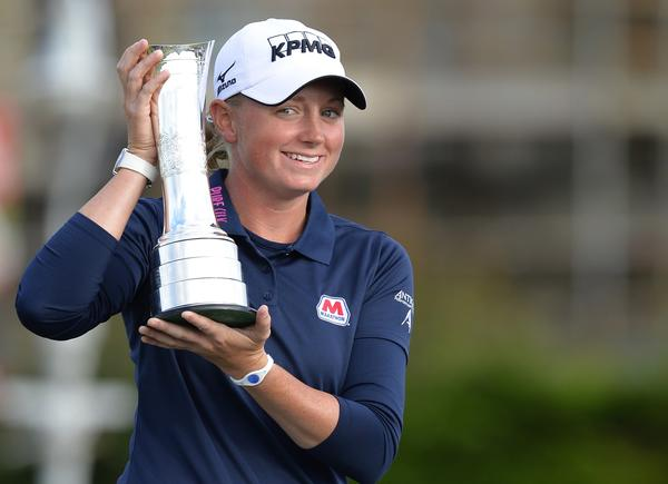 Stacy Lewis of the U.S. poses with the trophy on the Swilken Bridge after winning the Women's British Open.