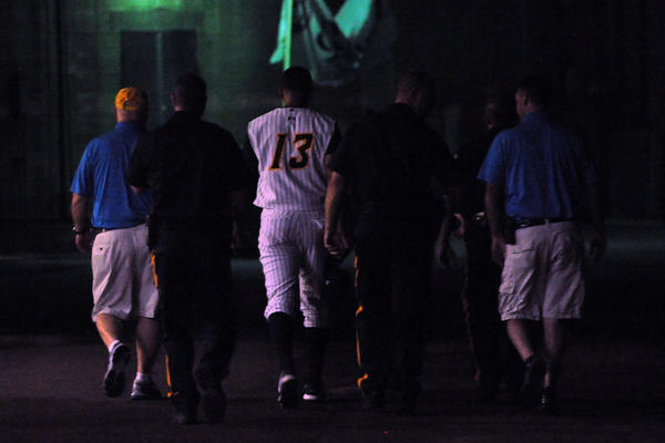 Trenton Thunder third baseman Alex Rodriguez is escorted to the locker room after leaving a rehab assignment game against the Reading Fighting Phils in Trenton, N.J.