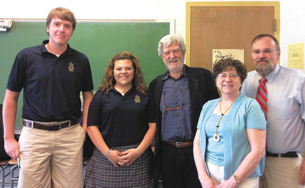 Maryland Poet Laureate Stanley Plumly visited St. Maria Goretti High School in May and spoke to several of the schools English classes. From left, Will Snyder and Amber deSantis, both sophomores, Plumly, and the students' English teachers, Marty Amrhein and Sam Cuthbert.