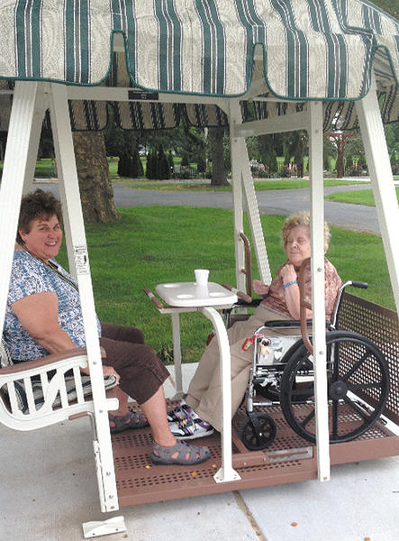 Betty Stoops and her granddaughter, Tammy, are shown enjoying Western Maryland Hospital Centers new wheelchair-accessible swing. Tammy Stoops is a recreational therapist at the center.