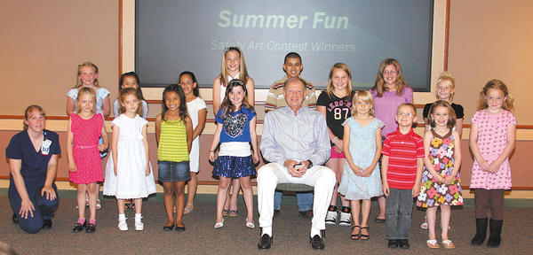 Pictured, front row, from left, Trauma and Emergency Services Manager Susie Burleson; Jessie Ann Wetzel, first place, kindergarten; Anna Jackson, third place, kindergarten; Tiara Brantley, third place, first grade; Emily Burke, first place, fourth grade; Surgeon in Chief of Trauma Services Dr. Marc Kross; Kassidy Meadows, second place, first grade; Reed Althouse, first place, first grade; Lily Weber, second place, kindergarten; and Joanna Whitmore, second place, third grade. Second row, Riley Shea Necessary, third place, third grade; Cayleigh Murphy, first place, second grade; Ileana Ekins, third place, second grade; Emily Askin, second place, fifth grade; Gage Curry, first place, fifth grade; Madison Oberholzer, third place, fifth grade; Brianna Simmons, second place, fourth grade; and Tierra Mimnall, second place, second grade. Not pictured are Grace K., first place, third grade; and Zoey R., third place, fourth grade.