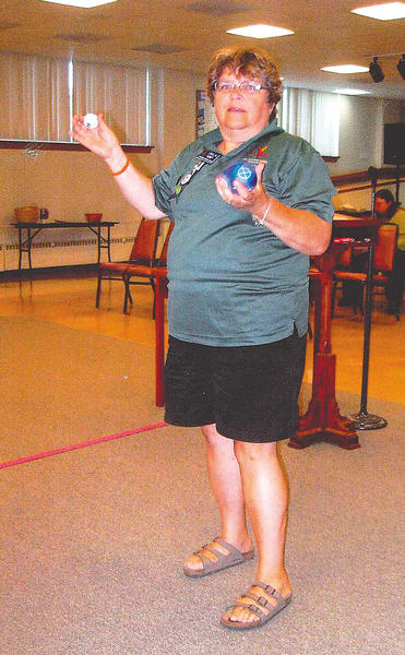 Carolyn Roney, a bocce coach for the Special Olympics, gives a demonstration of the game at a recent Tri-State Civitan Club meeting.