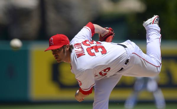 Angels starter C.J. Wilson delivers a pitch during the Angels' 6-5 loss to the Toronto Blue Jays on Sunday.